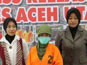 Tersangka N, digiring petugas Polres Aceh Utara. (Foto/Ist)